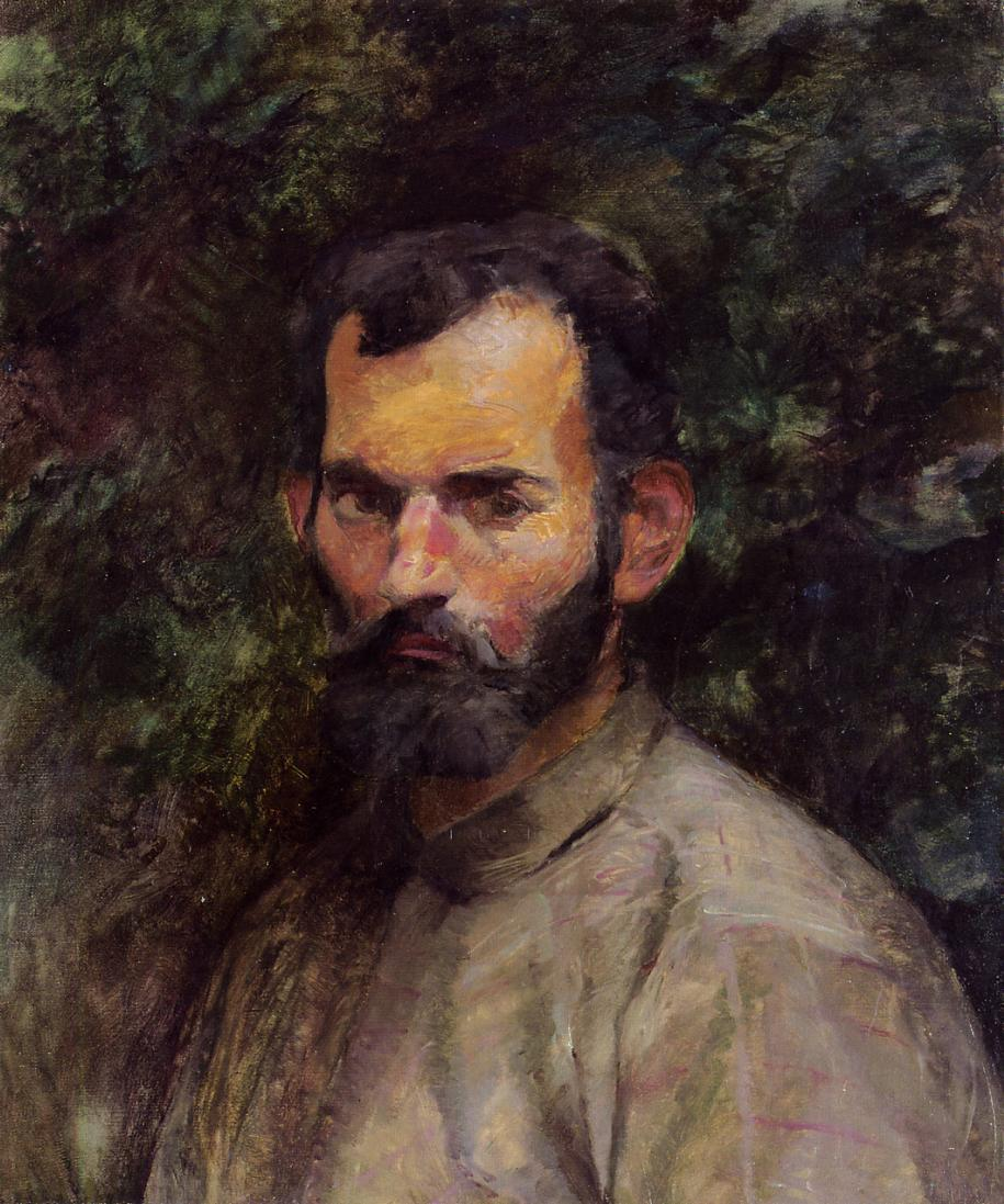 Portrait of young bearded man in simple shirt